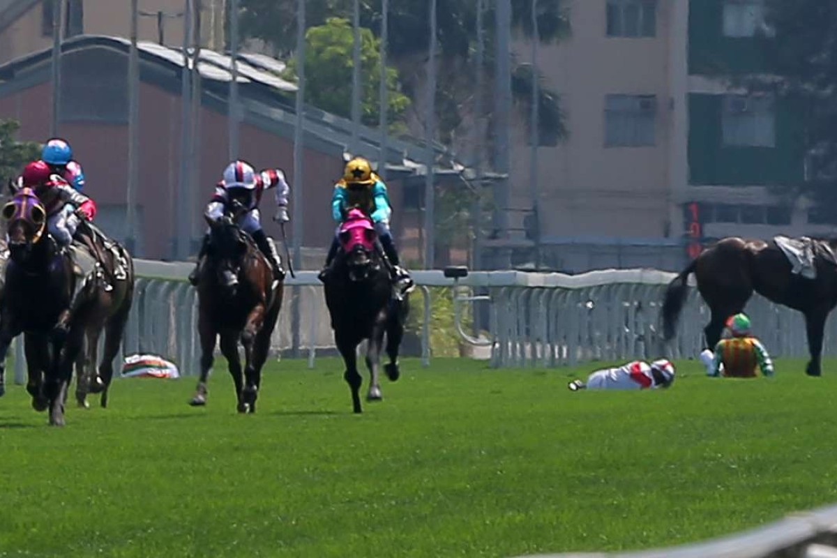 Nash Rawiller (on the ground, left), Vincent Ho (middle) and Karis Teetan (right) remain on the ground after a nasty fall at Sha Tin on Monday. Photos: Kenneth Chan