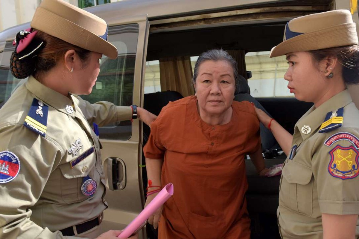 Lim Mony, a Cambodian senior officer from The Cambodian Human Rights and Development Association, leaves court in Phnom Penh. Photo: AFP