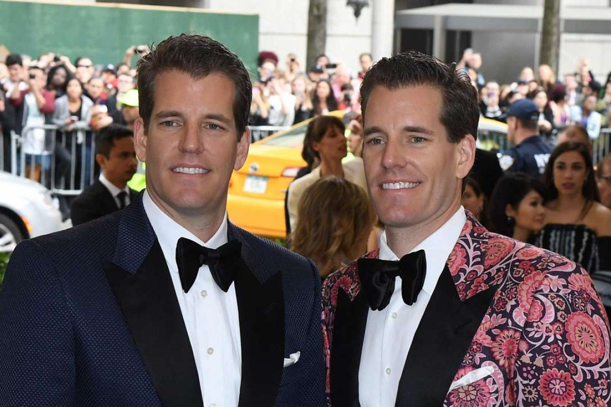 Cameron Winklevoss and Tyler Winklevoss arrive for the Costume Institue Benefit May 1, 2017 at the Metropolitan Museum of Art in New York. / AFP PHOTO / ANGELA WEISS