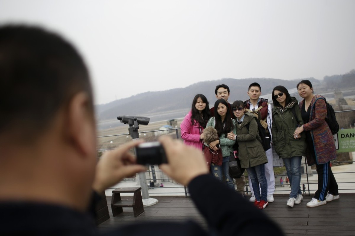 Chinese tourists at the Imjingak Pavilion in Paju, South Korea. Beijing has banned tour groups from visiting the nation in response to the THAAD deployment. Photo: AP