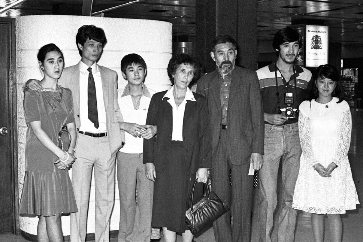 A White Russian family depart from Hong Kong's Kai Tak airport heading to Australia, in 1981.