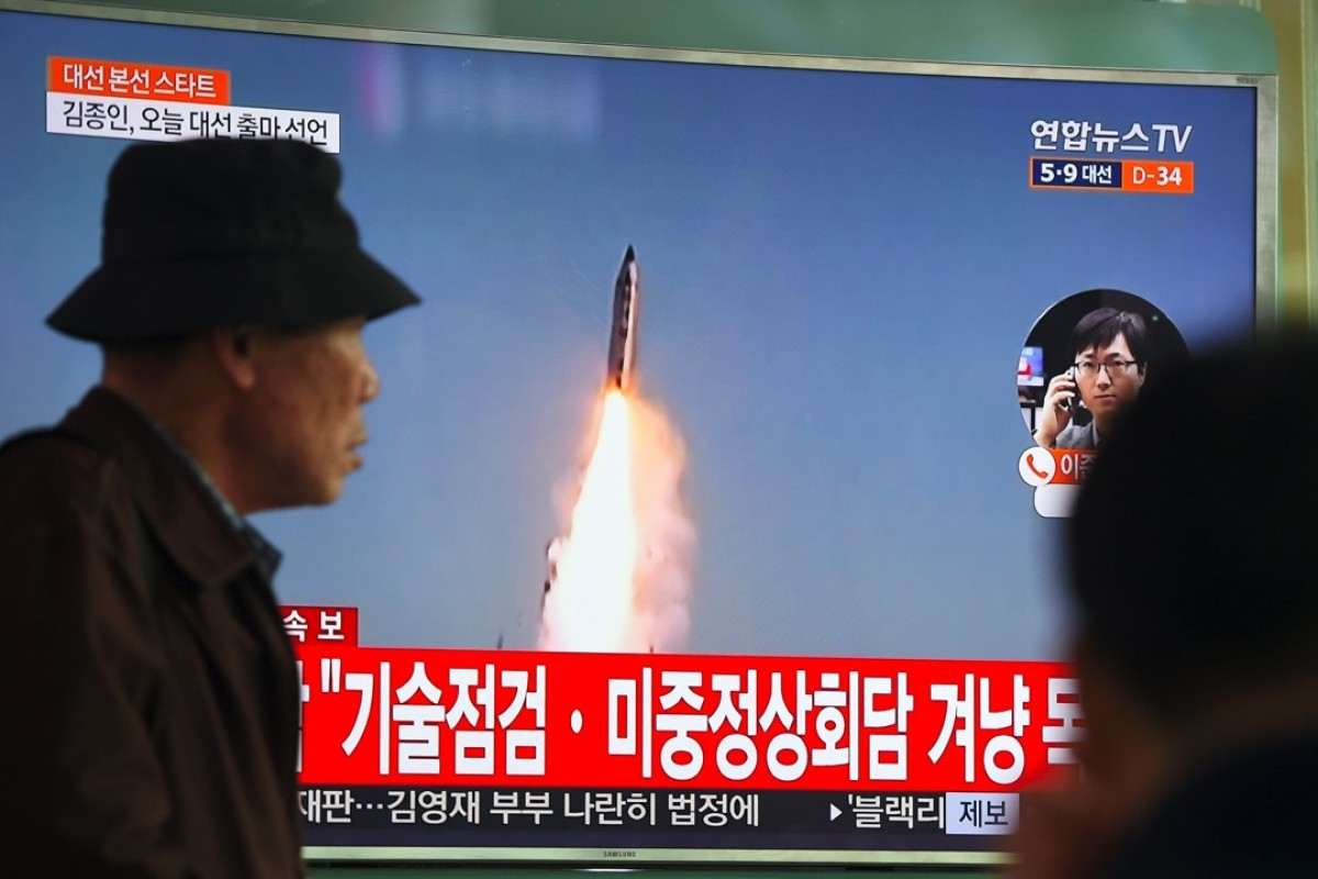 Television footage of a North Korean missile launch, at a railway station in Seoul. Photo: AFP