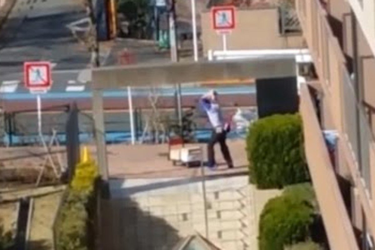 A Sagawa delivery man kicks and screams at a bunch of parcels outside an apartment building that went viral on YouTube. Photo: YouTube