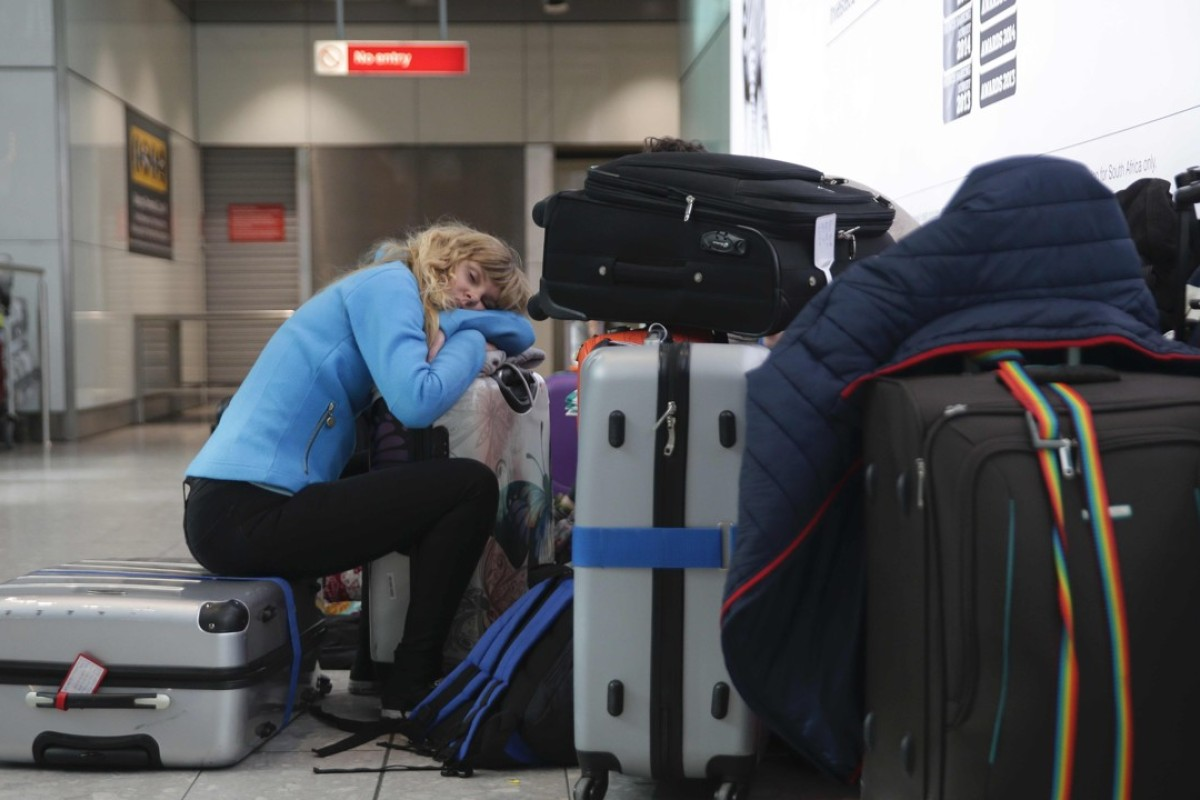 Heathrow is not among the top airports for sleeping if your flight's delayed, as British Airways passengers, such as this one, caught up in last weekend's computer-crash chaos can attest. Picture: AFP