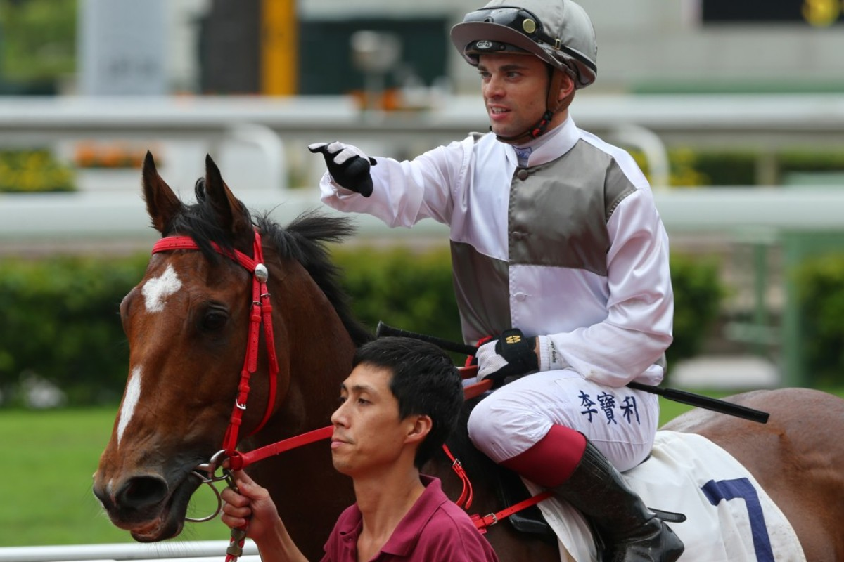Umberto Rispoli gives Ivictory a pat after his debut win. Photos: Kenneth Chan