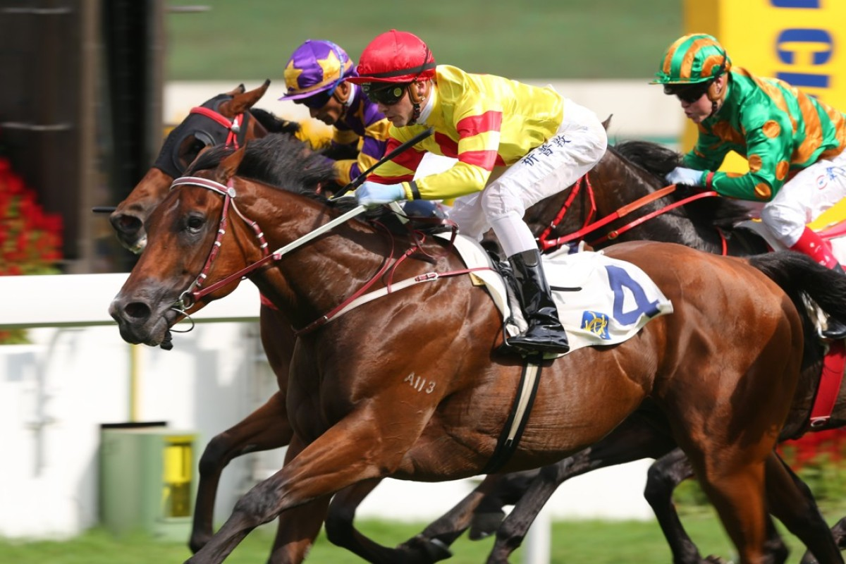 Sam Clipperton guides Booming Delight to victory in the Group Three Lion Rock Trophy. Photos: Kenneth Chan