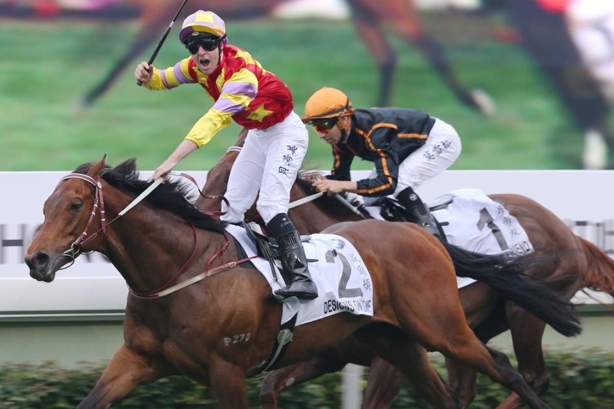 Tommy Berry salutes as Designs On Rome beats Able Friend in the 2014 Hong Kong Derby. Photos: Kenneth Chan