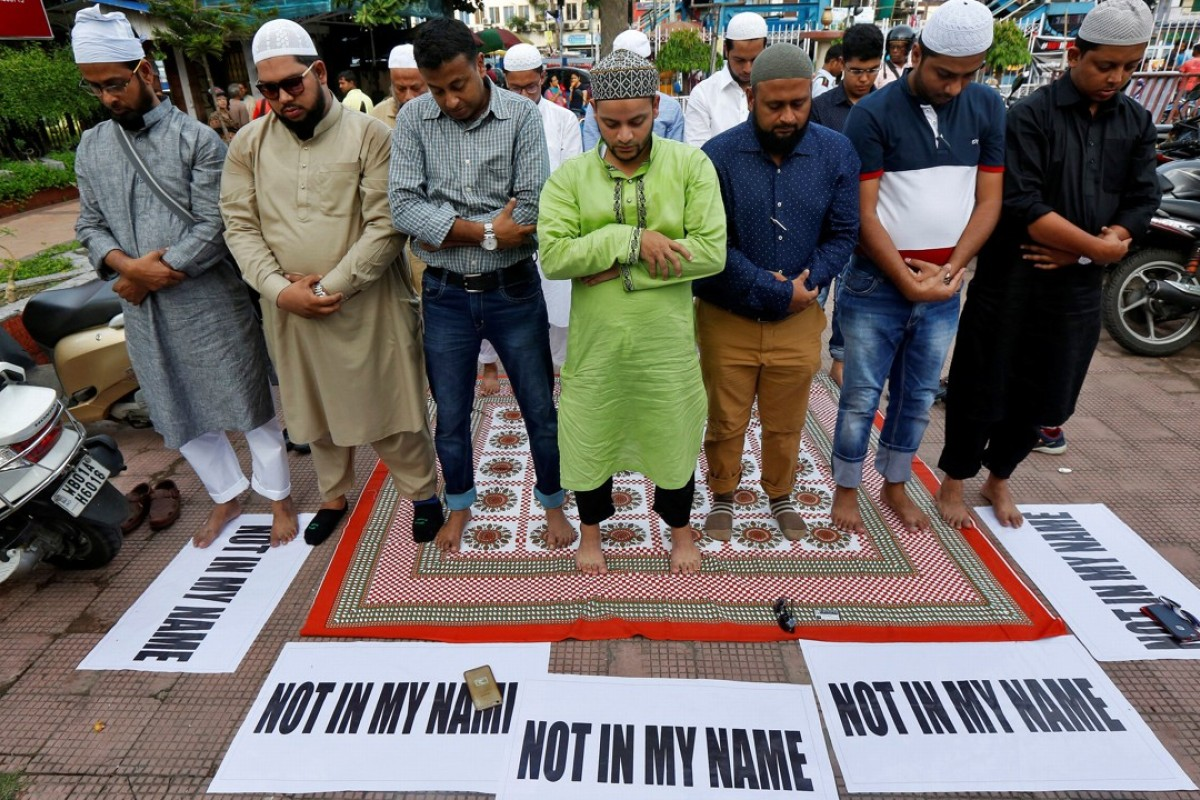 Muslims offer prayers in Kolkata as they take part in a protest against mob lynchings of Muslims who were accused of possessing beef. Photo: Reuters