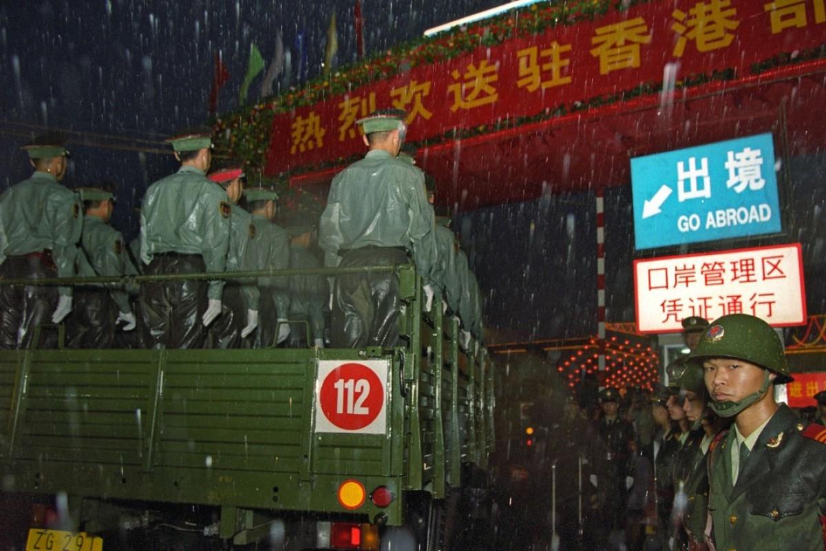 PLA convoys cross the border into Hong Kong on July 1, 1997. Picture: AFP