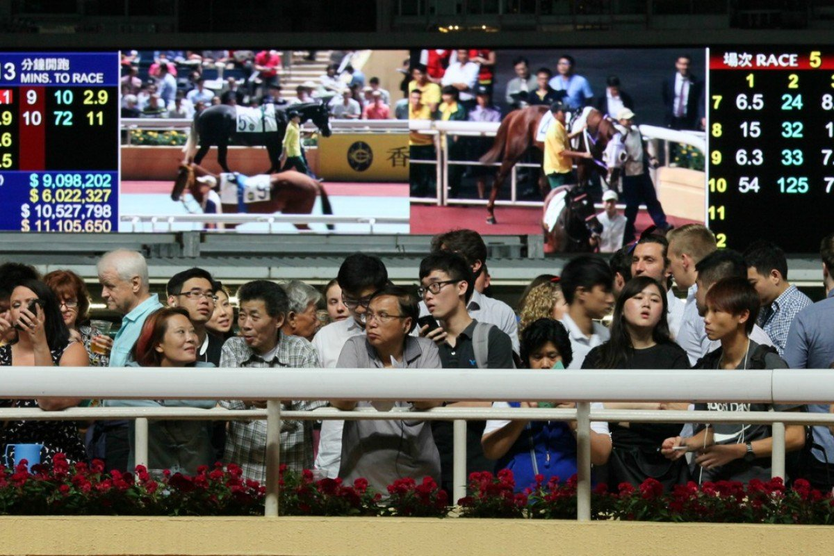 "Racing fans line up for a view of the horses at Happy Valley – investment in ""customers"" is paying dividends for the Jockey Club, says chief executive Winfried Engelbrecht-Bresges. Photos: Kenneth Chan"