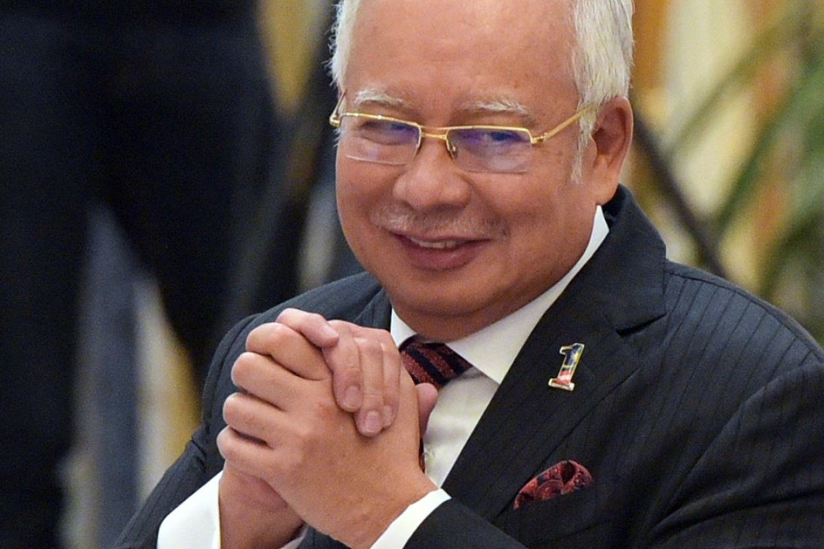 Malaysian Prime Minister Najib Razak must court the civil service vote if he is to cling to power. But its bloated nature could be financially disastrous for the country. Photo: AFP