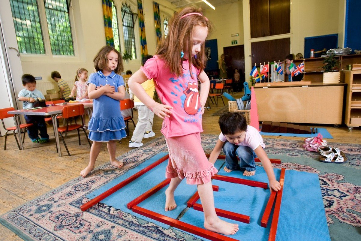 Children enjoy educational play at a Paint Pots Montessori School in London. Picture: Alamy