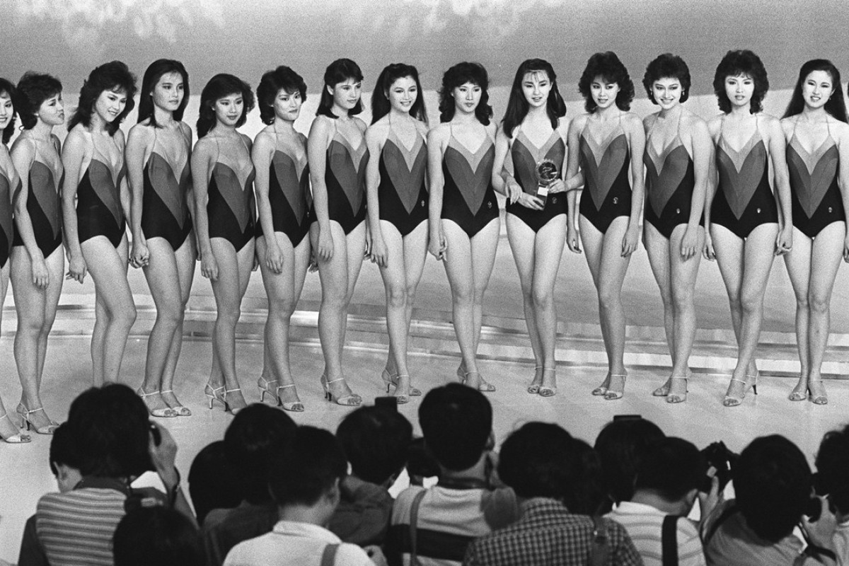 Fifteen semi-finalists in the 1983 Miss Hong Kong contest pose for photographers after being selected to take part in the final.