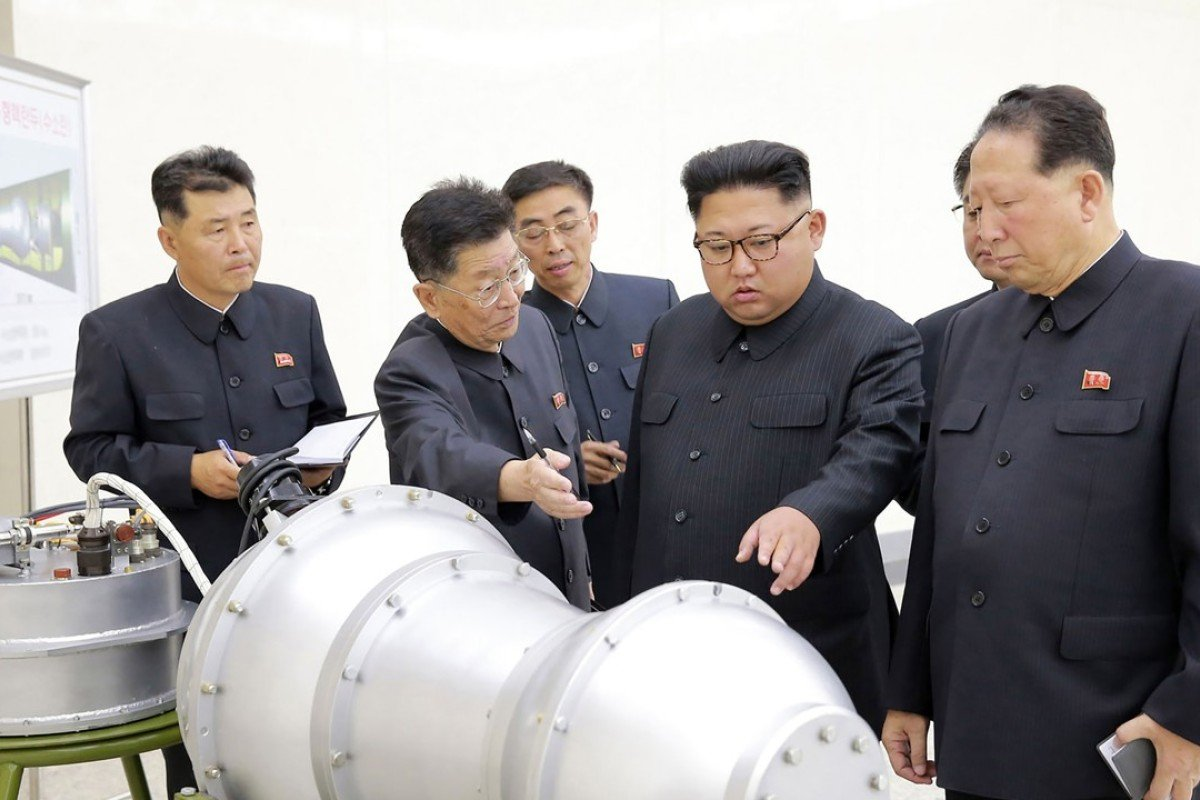North Korean leader Kim Jong-un inspects what is said to be a miniaturised hydrogen bomb. Photo: AFP
