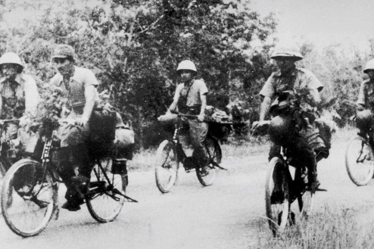 Bike-riding Japanese soldiers in Malaya, during the second world war.