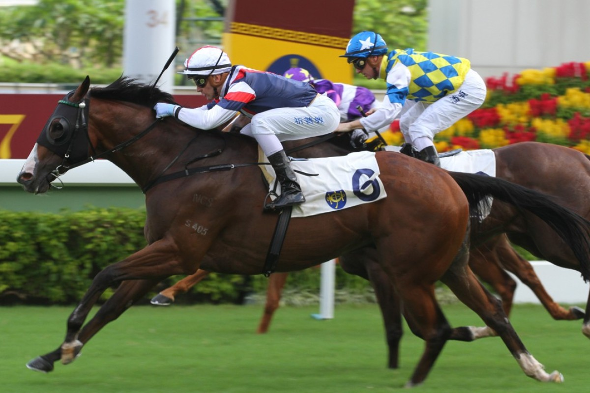 Sam Clipperton drives home Bossiee to win at Sha Tin on Sunday. Photos: Kenneth Chan