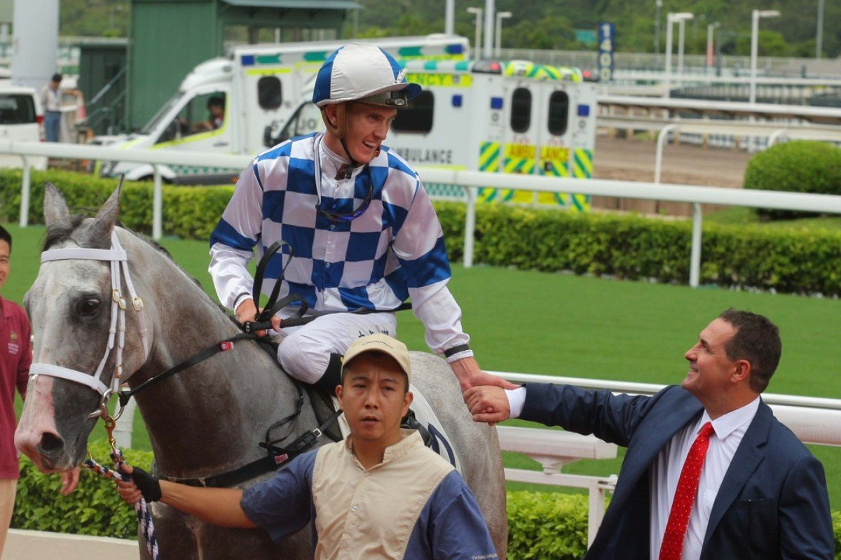 Chad Schofield greets winning trainer Michael Freedman after Silverfield scored at Sha Tin on September 24. Photos: Kenneth Chan.