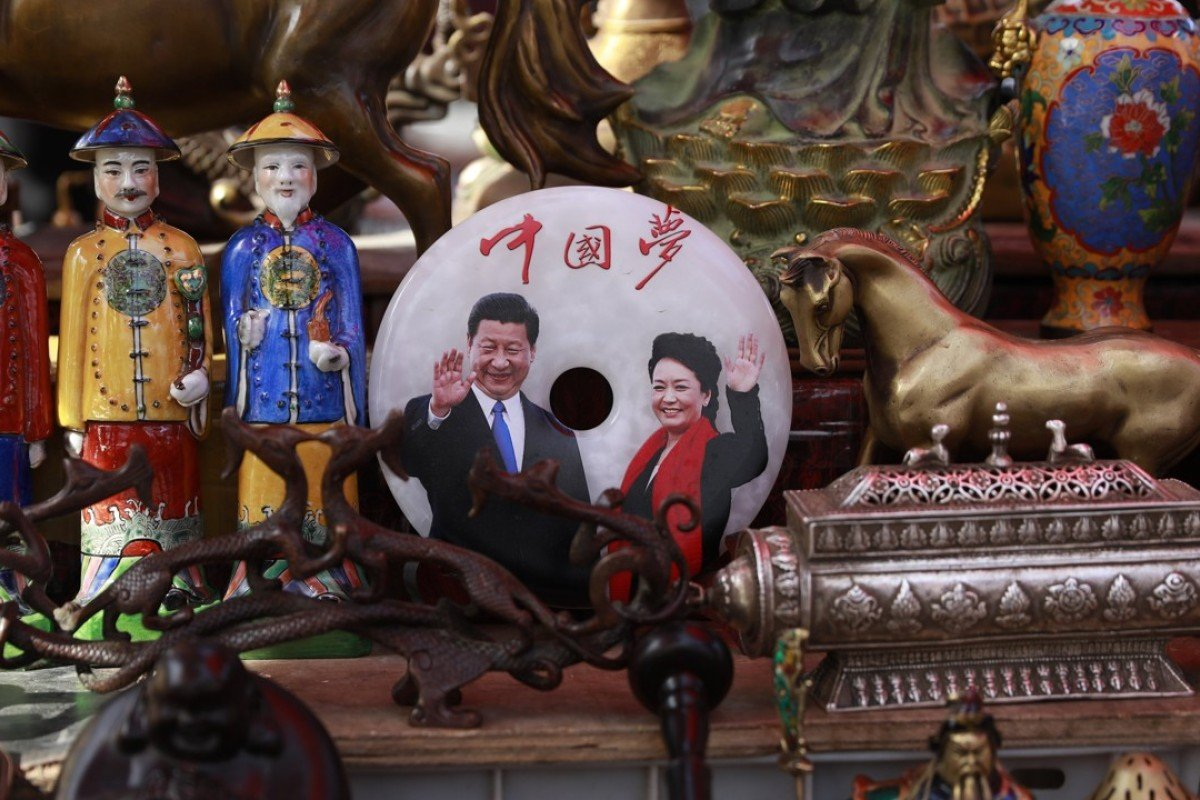 A jade plaque with a picture of Chinese President Xi Jinping and his wife Peng Liyuan below the words 'China Dream'. Photo: EPA