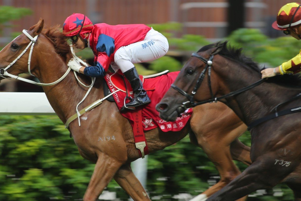 Matthew Chadwick guides The Golden Age to victory at Happy Valley on Sunday. Photos: Kenneth Chan