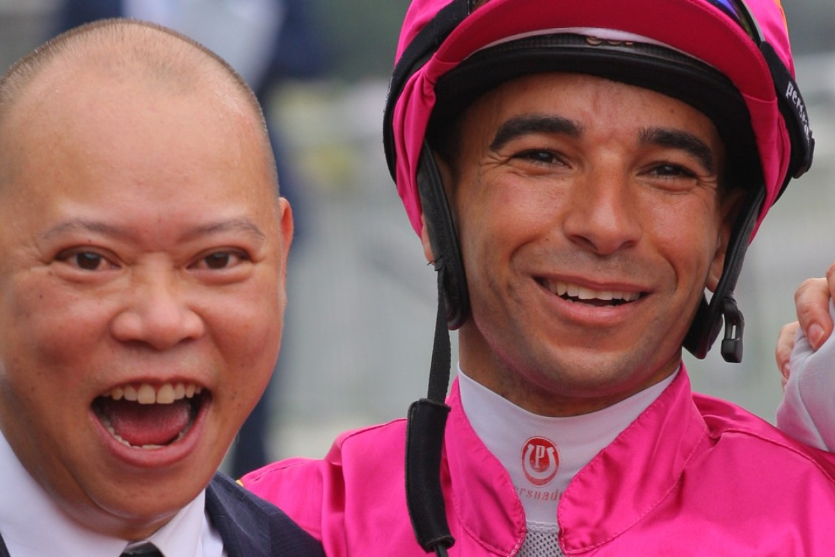 Chris So celebrates a win with jockey Joao Moreira Photos: Kenneth Chan.