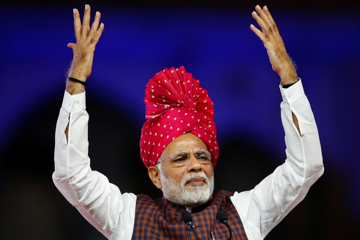 Narendra Modi addresses supporters at a campaign rally in Ahmadabad, Gujarat's largest city. Photo: Reuters