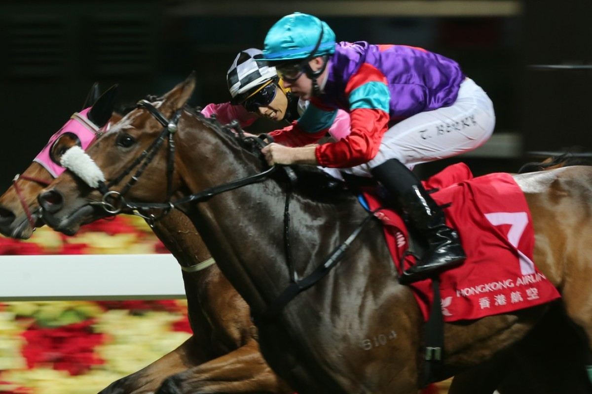 Tommy Berry guides Singapore Sling to victory at Happy Valley on Wednesday night. Photo: Kenneth Chan