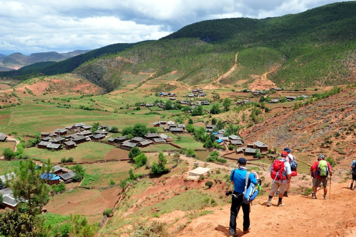 Trekking to a traditional farm stay in the remote village of Xishan, in China's Yunnan province. Picture: Adrian Bottomley