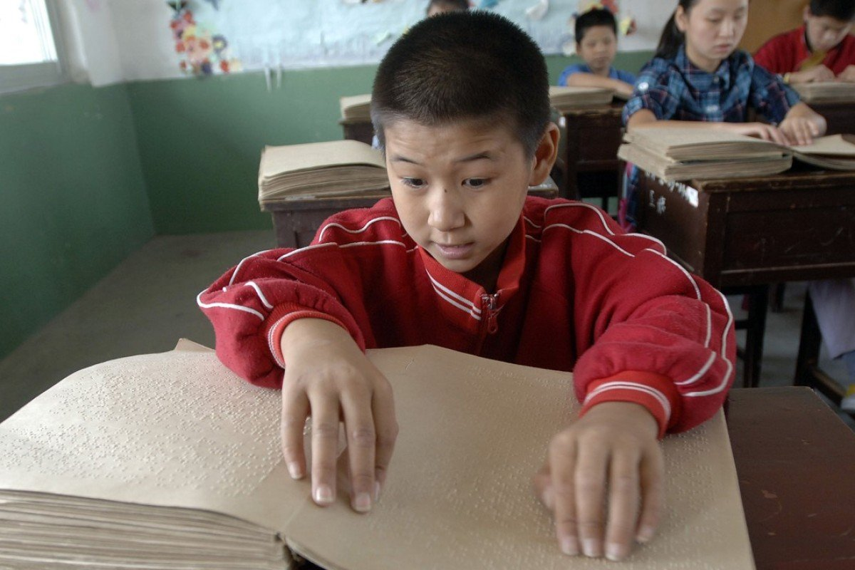 Children read Chinese Braille at a school for the blind in Hefei, Anhui province. Picture: AFP