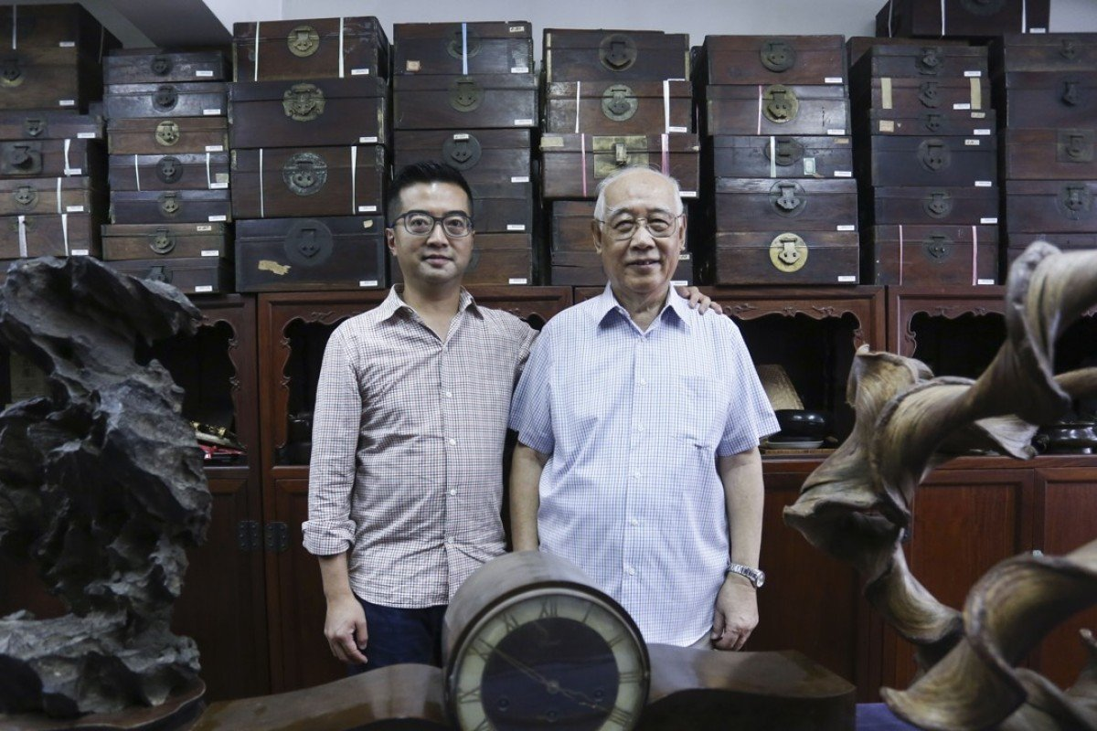Antiques trader Hei Honglu with his son, Andy Hei, in his office, in Tsim Sha Tsui. Picture: Jonathan Wong