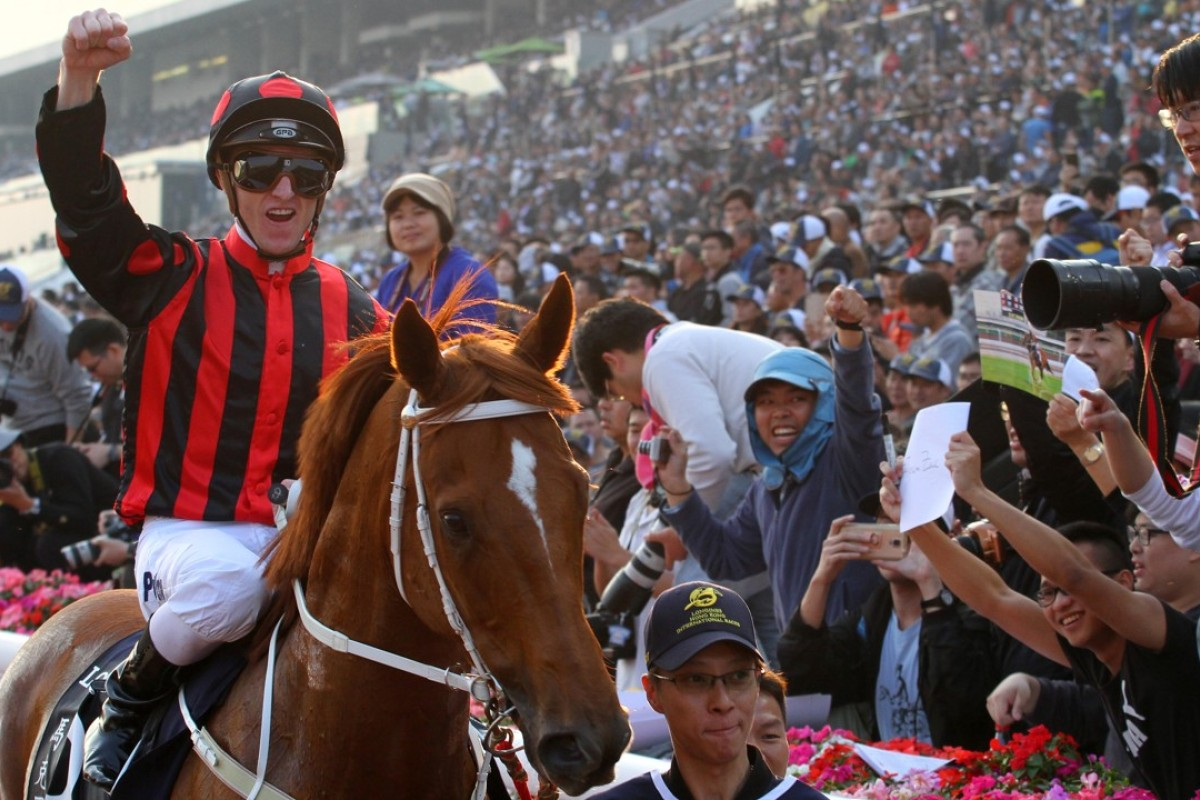 Zac Purton celebrates Time Warp's win in the Group One Hong Kong Cup. Photos: Kenneth Chan