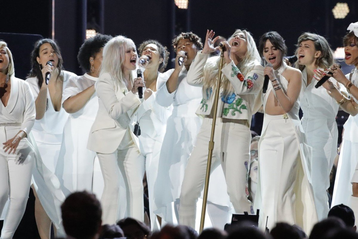 Kesha (centre) is joined on stage by a multitude of other singers as they perform 'Praying' at Sunday's Grammy Awards ceremony in New York. Photo: Reuters