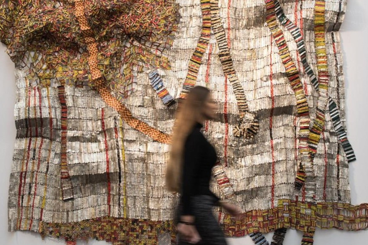 An artwork by El Anatsui, on view in galleries.