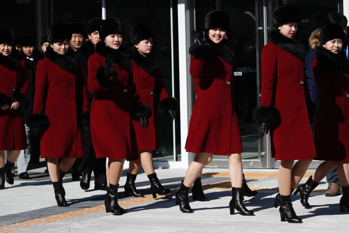 Members of North Korea's Samjiyon Orchestra and art troupe wave as they leave the Gangneung Arts Center on Wednesday, the day before giving their first performance in South Korea since 2002. Photo: AP