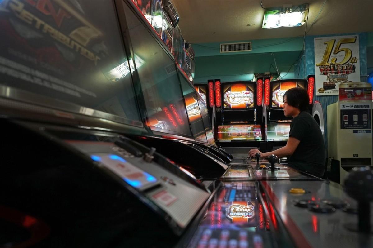 E-sports player Yota Kachi plays Bandai Namco Holdings Inc's video game Tekken, at an arcade in Tokyo. Photographer: Kentaro Takahashi/Bloomberg
