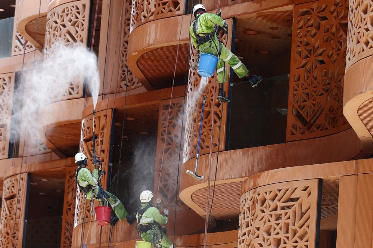Workers clean student dorms in Masdar City. Photo: AFP