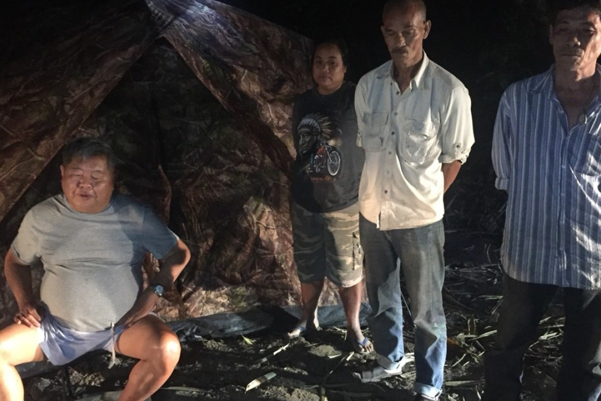 Premchai Karnasuta, 63, left, at his campsite where he and others in his group were arrested by Thai wildlife authorities. Photo: AP