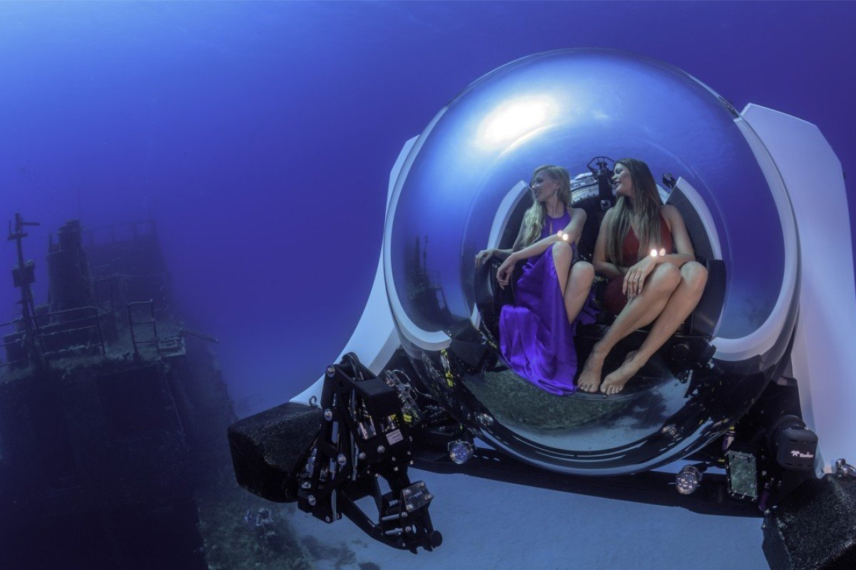 The submarine features an acrylic pressure hull that provides panoramic underwater views.