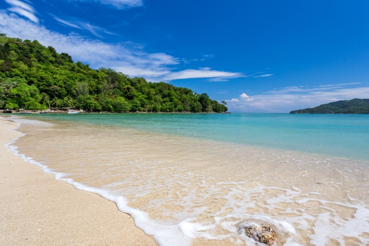 The beach in front of Rosewood Phuket.