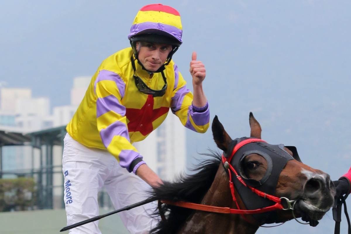 Ryan Moore gives the thumbs up after winning the BMW Hong Kong Derby. Photo: Kenneth Chan