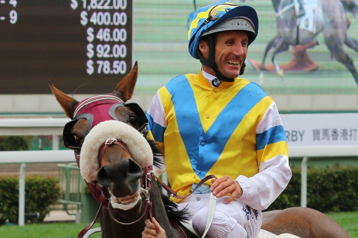 Damien Oliver is all smiles after winning with Grand Chancellor at Sha Tin on Sunday. Photos: Kenneth Chan