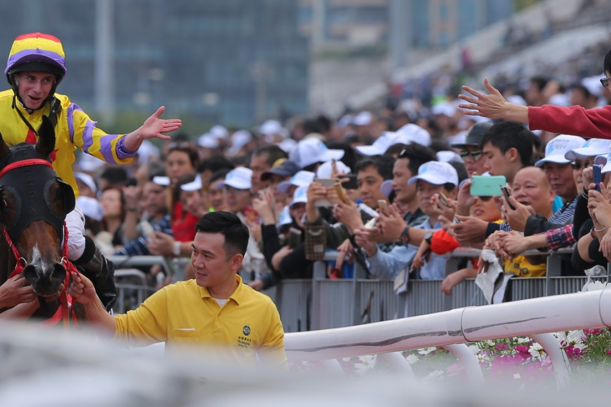 Ryan Moore interacts with a fan after winning the BMW Hong Kong Derby. Photos: Kenneth Chan