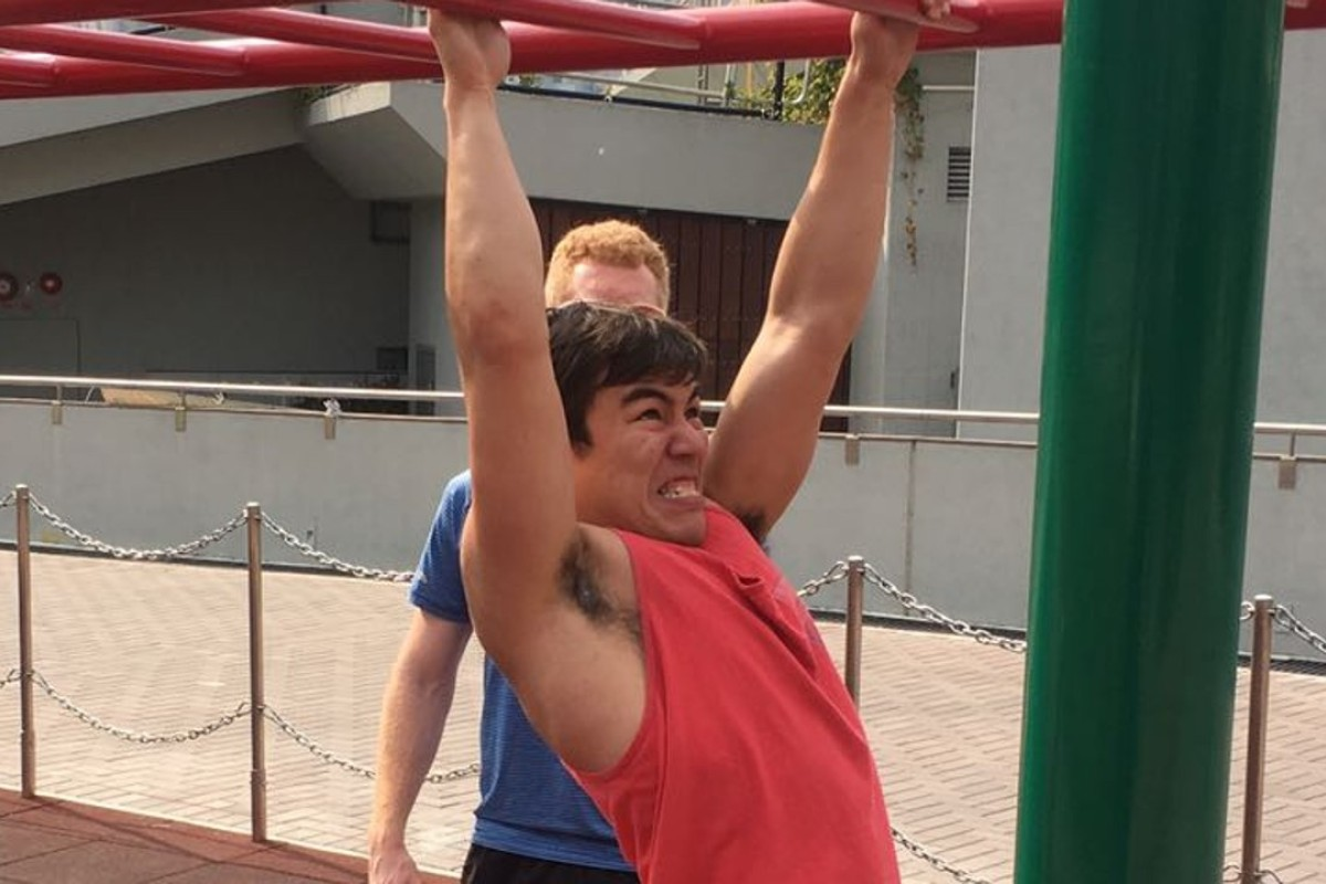 Post reporter Ben Young masters the monkey bars. Photo: Sam Agars