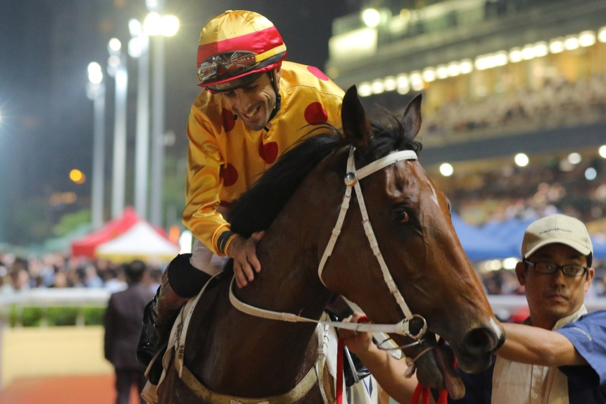 Alberto Sanna gives Gold Mount a pat after winning the Class One Hong Kong Vase on Wednesday night. Photo: Kenneth Chan