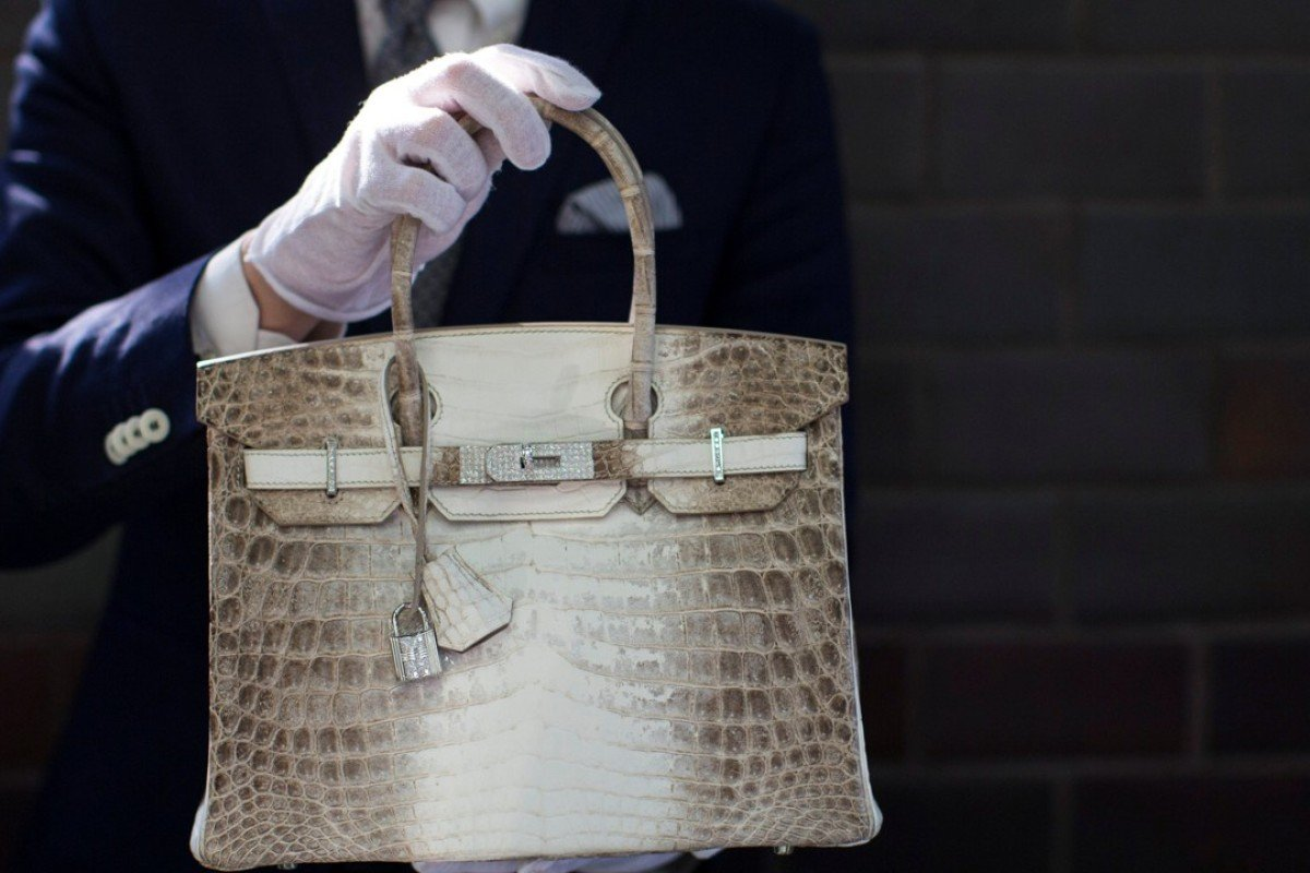 An Employee Holds A Hermès Diamond And Himalayan Nilo Crocodile Birkin Handbag Photo Mario