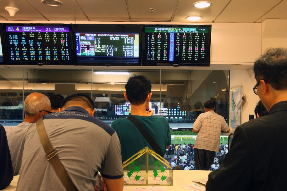Punters betting at Happy Valley. Photos: Kenneth Chan