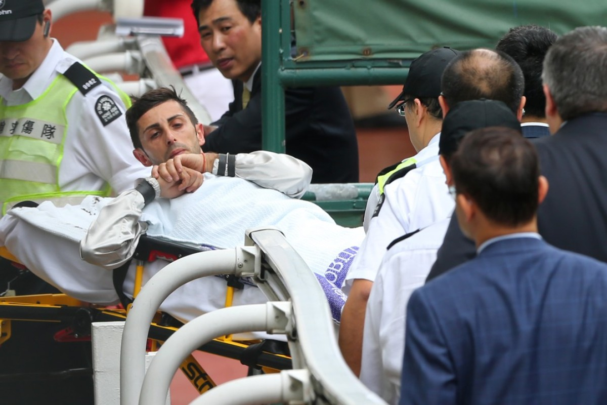 Alberto Sanna goes to hospital after dislocating his shoulder during a race. Photos: Kenneth Chan