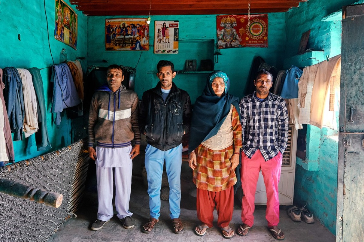Om Pati is the mother of seven sons, including (from left) Sandeep, Sanjay and Suresh. Picture: Poras Chaudhary