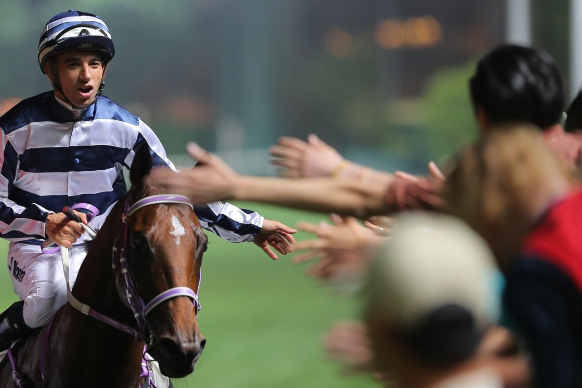 Joao Moreira celebrates Eighty Eighty's win with the fans. Photos: Kenneth Chan