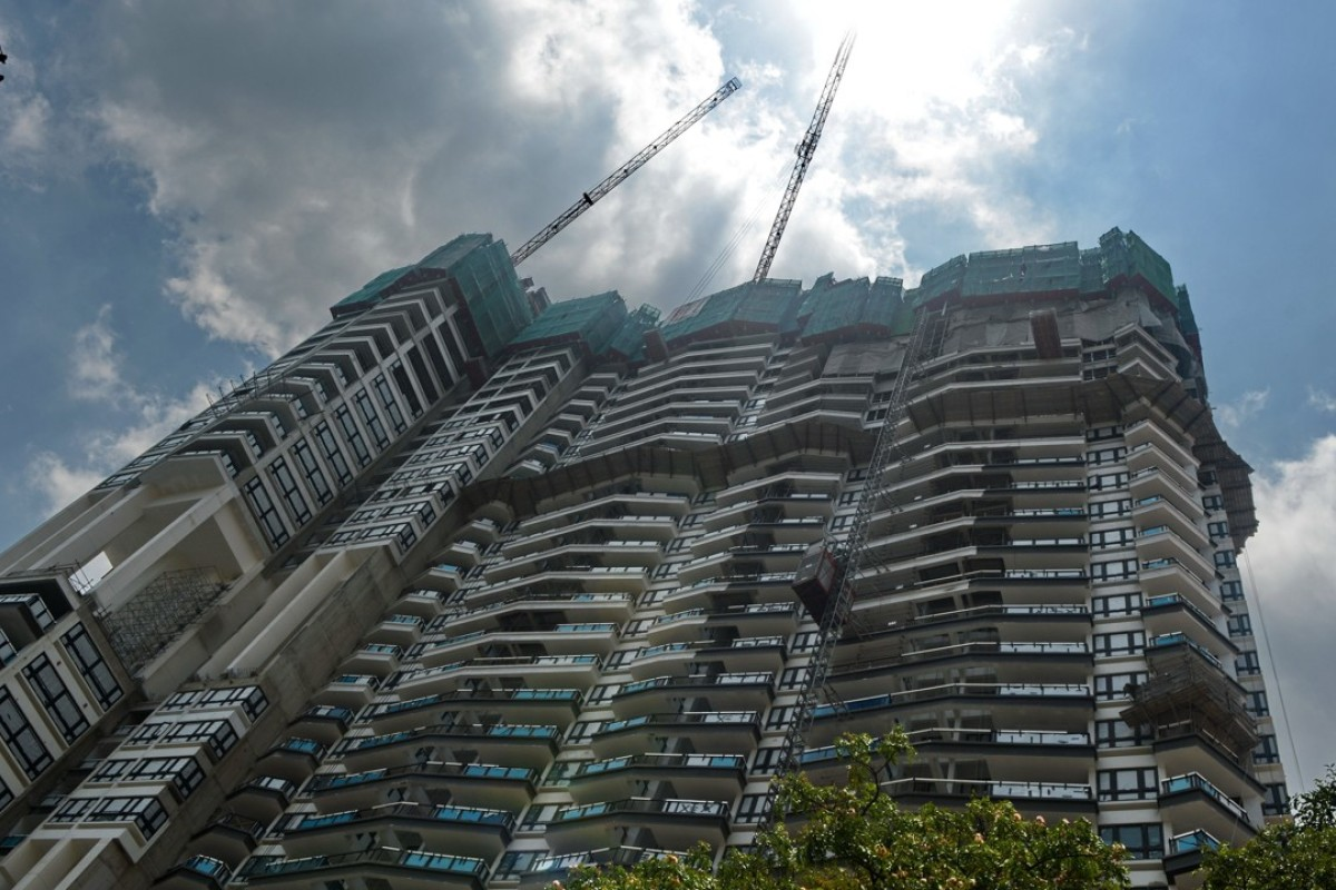 A private condominium near the business district in Singapore. A surge in en bloc purchases is boosting property prices throughout the Lion City. Photo: AFP