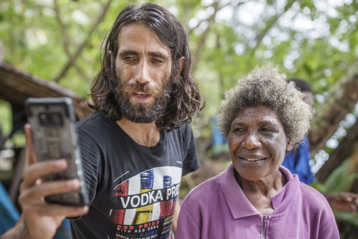 Iranian-born Kurd Behrouz Boochani with a local on Manus Island. Pictures: Jonas Gratzer